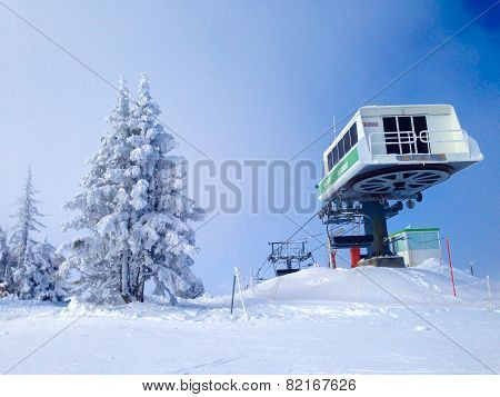 Chairlift cable car and ski slopes in the mountains