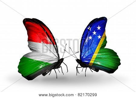 Two Butterflies With Flags On Wings As Symbol Of Relations Hungary And Solomon Islands