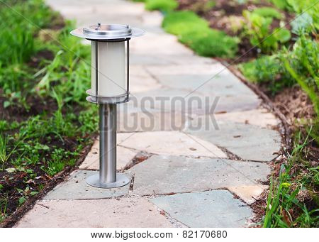 Solar-powered Lamp On Garden Path.