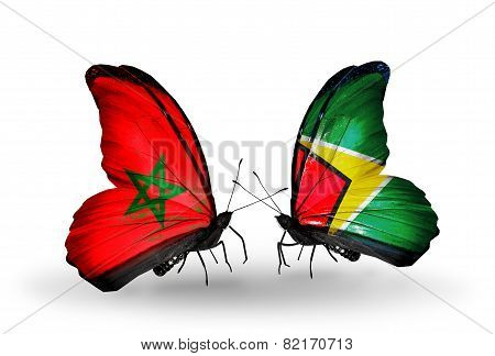 Two Butterflies With Flags On Wings As Symbol Of Relations Morocco And Guyana