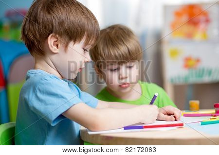 children painting in nursery at home