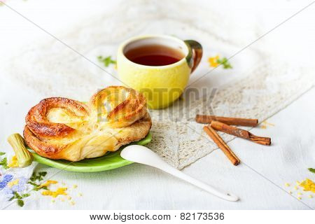 buns and cup of tea on tray