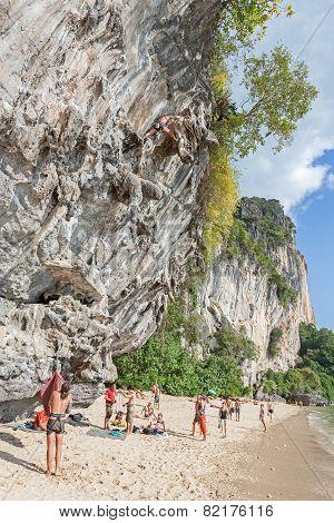 Rock Climbers And Tourists On Railay Beach.
