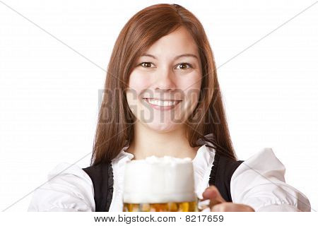 Happy smiling Bavarian woman in dirndl holding Oktoberfest beer stein.