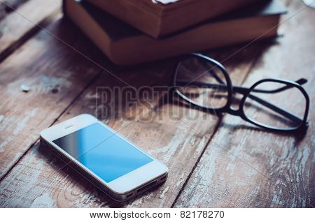 Books, Smartphone And Glasses