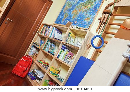 Part Of Nursery Room Interior With Wooden Shelving