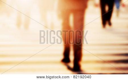 Businessman walking on the street. Blur, vintage mood. Pedestrians in the background