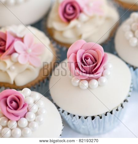Wedding cupcakes in silver foil wrappers