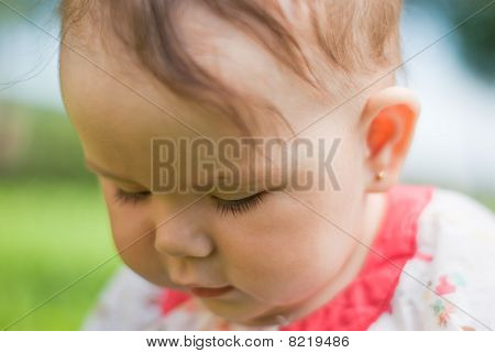 Portrait Of A Little Girl, Her Face Close-up