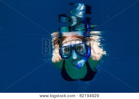 Underwater portrait of woman snorkeling in a tropical lagoon