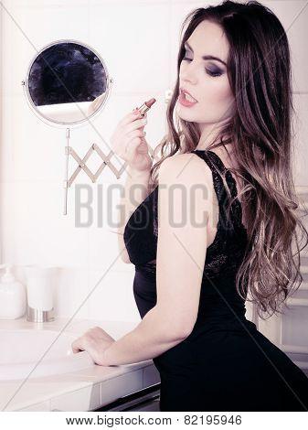 Beautiful Woman With Lipstick In Bathroom.