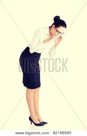 Young business woman bending down and looking. .
