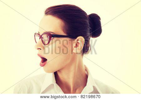 Profile of shocked, surprised businesswoman in eyeglasses.