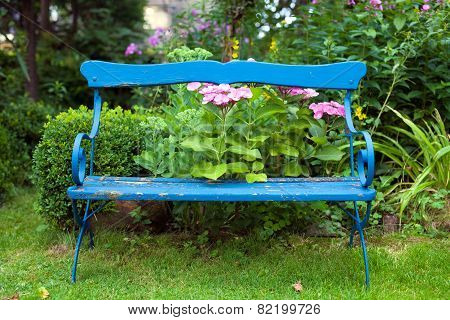 Old Blue Bench At The Garden