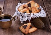 picture of traditional  - Traditional jewish Hamantaschen cookies for Purim  and coffee in ancient cup on a wooden table - JPG