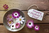 stock photo of happy day  - Silver Bowl With Label With English Text Happy Mothers Day With Purple And White Cosmea Blossoms On Wooden Background Vintage Retro Or Rustic Style - JPG