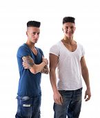 stock photo of mohawk  - Portrait of Two Young Attractive Men in Trendy Attire - JPG