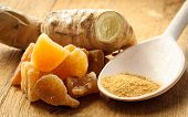 stock photo of home remedy  - Three kinds of ginger - ground spice, fresh, and candied on rustic table. Healthy eating home remedy for nausea upset stomach colds.