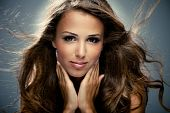 picture of beautiful face  - young brunette woman with long flying hair studio shot - JPG