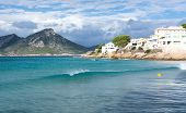picture of elm  - Wave of turquoise water in Sant Elm Majorca in October - JPG