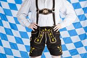 foto of upper thigh  - Bavarian man with black Oktoberfest leather pants  - JPG