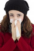 foto of sneezing  - Sick adult woman sneezing because of flu - JPG