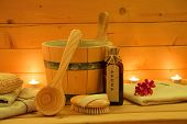 stock photo of sauna  - wooden sauna and sauna accessories in the candlelight - JPG