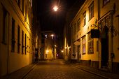 foto of roof-light  - Covered with paving stones street in Old Riga Latvia at night - JPG