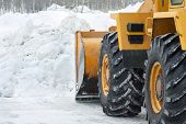 stock photo of bulldozer  - The bulldozer cleans the road after a blizzard - JPG