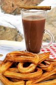 picture of churros  - Hot chocolate drink and churros with receipt and change Costa del Sol Malaga Province Andalucia Spain Western Europe.