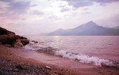 image of italian alps  - lonely sunset beach at garda lake italian landscape - JPG