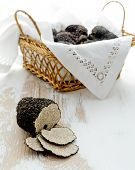 picture of truffle  - Cut black truffle on old white table - JPG