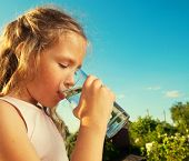 image of glass water  - Girl holding glass with water - JPG