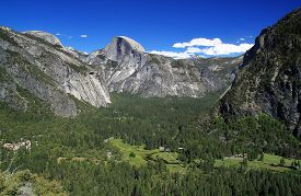 image of granite dome  - A panoramic view of Yosemite Valley and Half Dome mountain - JPG