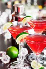 stock photo of vodka  - A cosmopolitan or informally cosmo is a cocktail made with vodka triple sec cranberry juice and freshly squeezed lime juice or sweetened lime juice - JPG