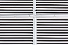 stock photo of louvers  - Metallic gray slanted louvers as abstract industrial background - JPG