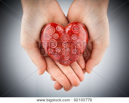Red Stone Heart In Young Woman Hands, Vignette Toned