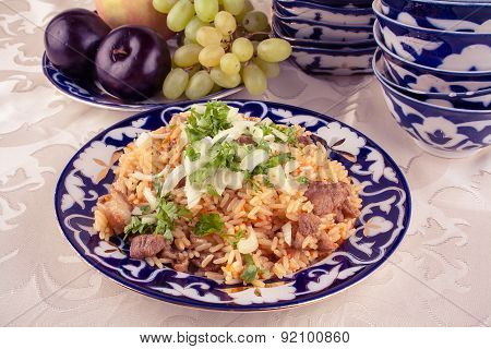 Traditional Uzbek Meal Called Pilaf And Onion In Vintage Look