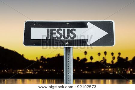 Jesus direction sign with sunset background