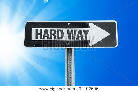 Hard Way direction sign with a beautiful day