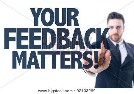 Business man pointing the text: Your Feedback Matters