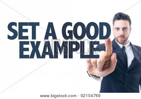 Business man pointing the text: Set a Good Example