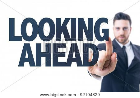 Business man pointing the text: Looking Ahead