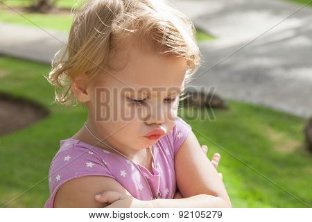 Funny Caucasian Blond Baby Girl Resentfully Pouts