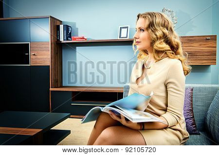 Smiling woman sitting on a couch in the living room.