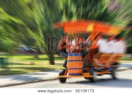 Abstract Background.   Bierbike With Tourists Is Entering The Gate Vajdahunyad Castle