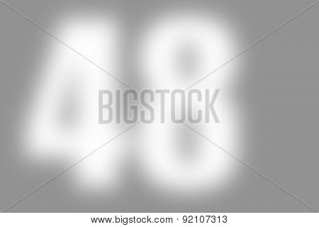 gray abstract background with defocused white international number 48 on the left