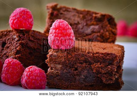 Chocolate Brownies And Raspberries