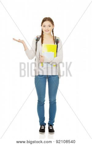 Teenage girl with school backpack and open hand.