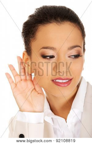 Beautiful african american businesswoman overhears.